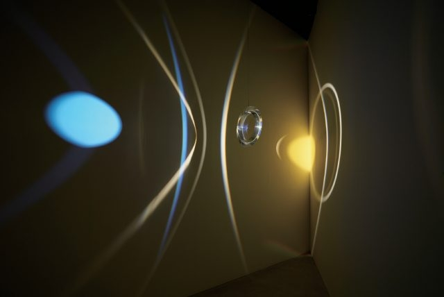 'Your museum primer', Acrylic prism ring, colour effect-filter glass (yellow), spotlight, LED light, motor, wire, Dimensions variable, 2014