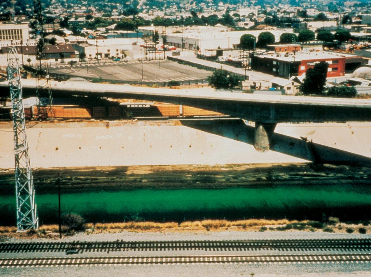 <strong>'Green river'</strong>, 1998, Uranine, water, Bremen, Germany, 1998 Photo: Helmut Wieben Courtesy of the artist; neugerriemschneider, Berlin; and Tanya Bonakdar Gallery, New York © Olafur Eliasson