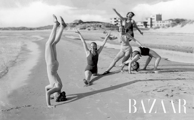 Women doing gymnastics on the beach, historic picture from about 1940