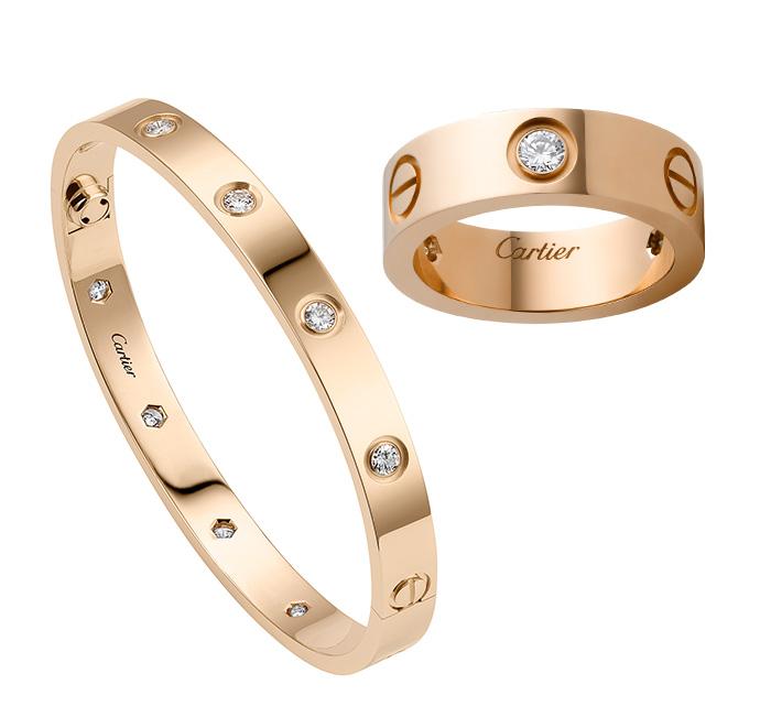 스크루 모티프 위치에 다이아몬드가 세팅된 핑크 골드 러브브레이슬릿 핑크 골드 소재의 러브 링