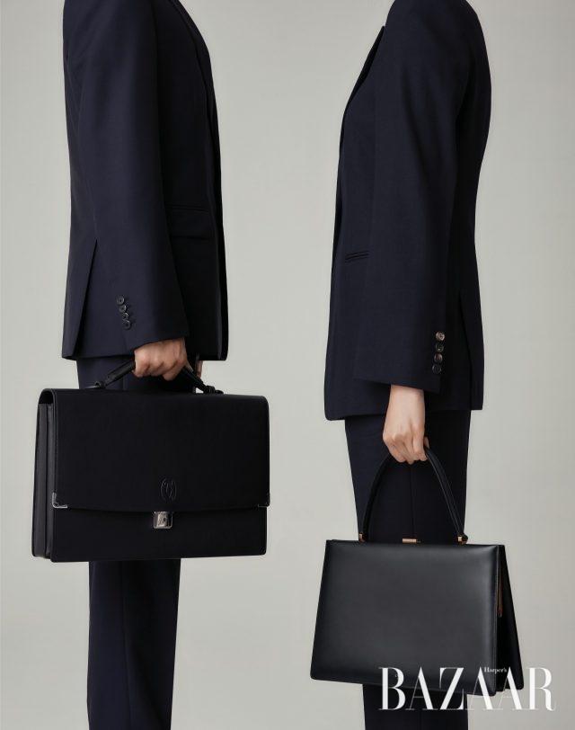 (왼쪽부터) 남자 모델이 입은 수트는 300만원대로 Prada, 브리프케이스는 347만원으로 Cartier. 여자 모델이 입은 재킷은 200만원대, 팬츠는 100만원대로 모두 Victoria Beckham by Mue, 스퀘어 토트백은 Céline.