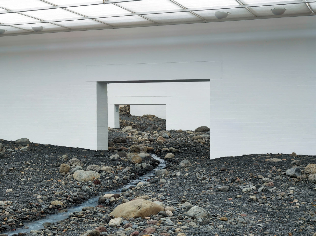 <strong>'Riverbed'</strong>, Water, blue basalt, wood, steel, foil, hose, pumps, cooling unit, Louisiana Museum of Modern Art, Humlebaek, Denmark, 2014 Photo: Anders Sune Berg Courtesy of the artist;  neugerriemschneider, Berlin; and Tanya Bonakdar Gallery, New York © Olafur Eliasson