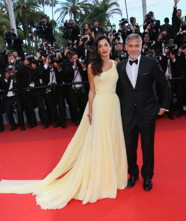 CANNES, FRANCE - MAY 12: George Clooney and Amal Clooney attend the Money Monster Premiere during the 69th annual Cannes Film Festival on May 12, 2016 in Cannes, France. (Photo by Tony Barson/FilmMagic)