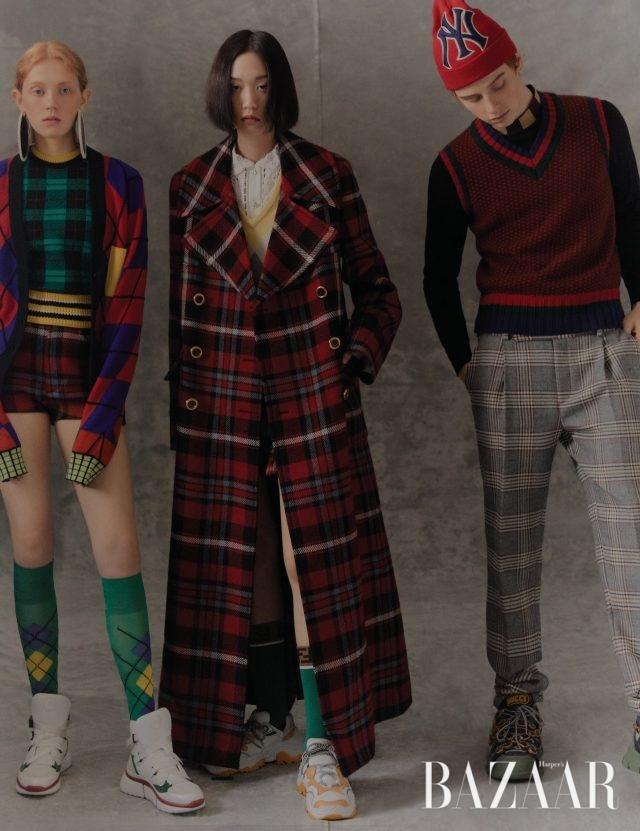 (왼쪽부터) 아니아가 입은 카디건은 193만원, 니트 톱은 90만원, 양말은 16만원 모두 Versace, 스커트는 100만원대 Miu Miu, 귀고리는 Loewe, 슈즈는 Chloé.채령이 입은 체크 코트는 520만원대, 이너로 입은 니트는 200만원대,셔츠는 가격 미정 모두 Miu Miu, 양말은 16만원 Fendi, 슈즈는 N°21.제이콥이 입은 니트 베스트는 62만원 Etro, 이너로 입은 톱은 63만원,팬츠는 135만원 모두 Fendi, 모자는 59만원, 슈즈는 189만원 모두 Gucci.