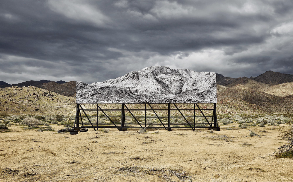 Giants, Death Valley, Billboard, Mars 5, 2017, 9:46 am, California, USA, 2017 Colour photograph, mat plexiglas, aluminium, wood / h. 105 × L. 170 cm | h. 41 5/16 × l. 66 15/16 in Courtesy the Artist and Perrotin ©JR-ART.NET